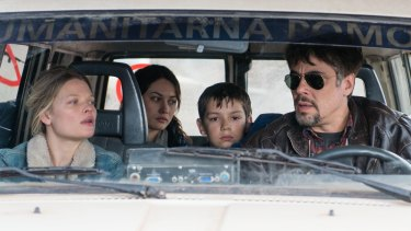 Benicio Del Toro, right, with Olga Kurylenko, Melanie Thierry and Eldar Residovic in the Bosnian war film <i>A Perfect Day.</i>