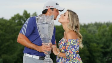 Jason Day of Australia with his wife Ellie after his six-stroke victory at The Barclays at Plainfield Country Club on August 30.