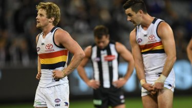 Honours even: Crows Rory Sloane (left) and Taylor Walker look after claiming two points in drawn result against the Pies.