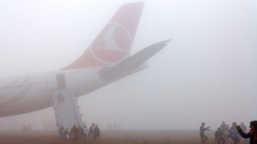 A passenger slides down the escape slide from the Turkish Airlines plane.