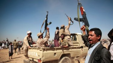 In this photo from January, tribesmen loyal to Houthi rebels chant slogans during a gathering aimed at mobilising more fighters into battlefronts to fight pro-government forces, in Sanaa, Yemen.