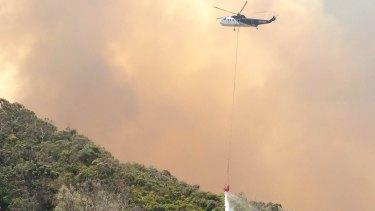 A helicopter tackles the blaze on Christmas Day.