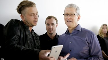 OneRepublic lead singer Ryan Tedder, seen here with Tim Cook, seems impressed.