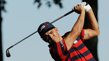 Supportive: Rickie Fowler enjoys the atmosphere at the World Cup of Golf.