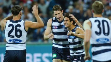 Nakia Cockatoo of the Cats celebrates a goal with Tom Hawkins (left) and Mark Blicavs.