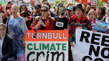 Environmentalists took to Melbourne's streets to protest a potential government loan to coal giant Adani.