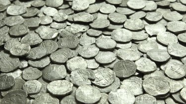 In an undated handout photo, silver coins recovered from the San Jose at the Investigaciones Marinas del Istmo conservation lab in Panama.