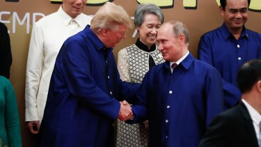 A handshake during the obligatory family photo was the closest US President Donald Trump and Russian President Vladimir Putin got.
