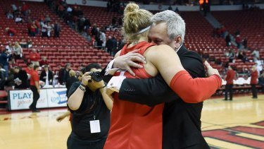 Job well done: Head coach Craig Neal hugs Hugh Greenwood after New Mexico defeated the UNLV Rebels 71-69 at the Thomas & Mack Center in Las Vegas, Nevada.