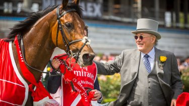 Owner Lloyd Williams greets Rekindling after winning the 2017 Melbourne Cup.