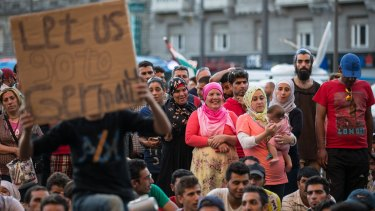 The migrants want to take a train from Budapest to Germany.