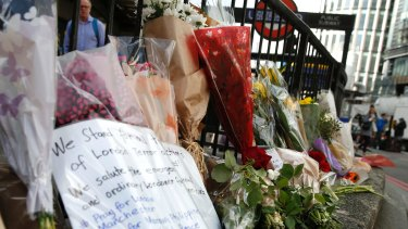 Floral tributes line the pavement outside Monument underground station on Monday, June 5.