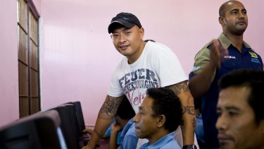 Andrew Chan teaches computer skills to inmates.