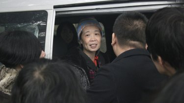 Hard times: Charlotte Chou requested a beanie for her release as her hair had turned almost completely grey during her years in prison.