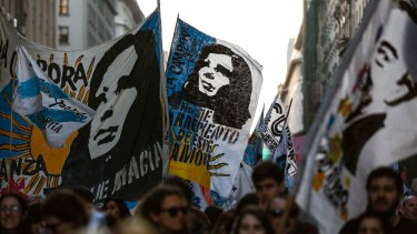 Demonstrators waving flags featuring images of former president Cristina Fernandez and late president Nestor Kirchner approach Plaza de Mayo in Buenos Aires in September.