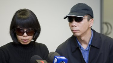 Robert Xie , here with his wife Kathy Lin, make a public appeal about the killings on July 29, 2009