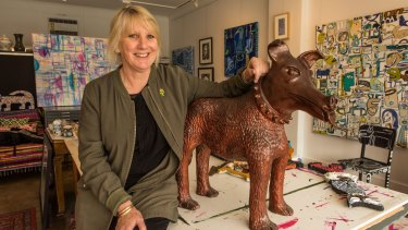 Bentleigh-based artist Pamela Irving with her sculpture Larry La Trobe the dog.