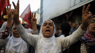 Protesters chant slogans in Istanbul after the attack.