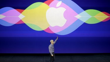 Apple chief executive Tim Cook takes the stage at the Bill Graham Civic Auditorium in San Francisco on Wednesday.