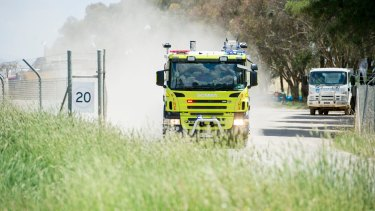 Firefighters at the scene of the Pialligo recycling plant fire last week.
