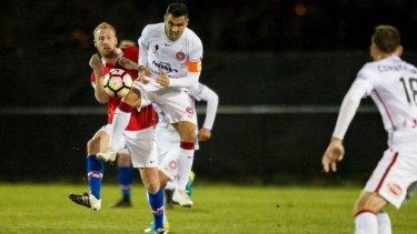 Canberra FC's Ian Gram and Wanderers player Dimas Delgado clash.