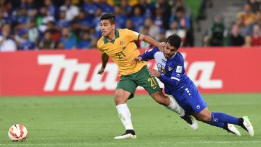 Man of the match: Massimo Luongo fights for the ball with Faisal Zayed Alharbi of Kuwait.