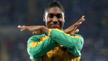 Caster Semenya brushes  the dust off her shoulders after the race.