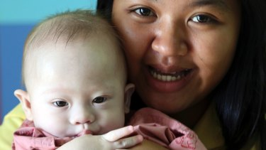 """Last year an Australian """"commissioning"""" couple left a child diagnosed with Down Syndrome with his surrogate mother in Thailand."""