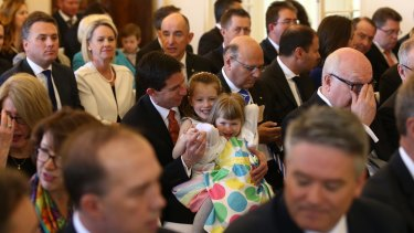 Senator Simon Birmingham with his daughters before he was sworn in as Education Minister.