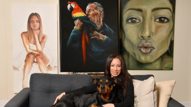 Irene Vides pictured with her portrait of John Singleton, which she will enter in this year's Archibald Prize.