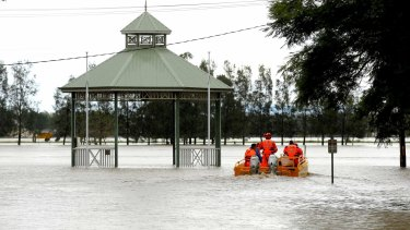 State Emergency Service crew set off in a flood boat to help residents in Raymond Terrace.