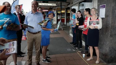 Running the gauntlet: John Alexander and Kristina Keneally hand out how-to-vote cards at Epping station on Friday.