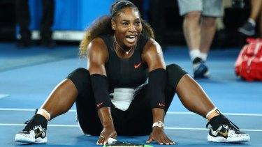 Serena Williams celebrates winning the Australian Open over her sister Venus.