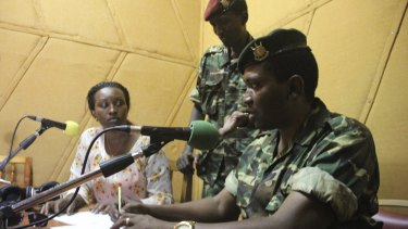 Major General Godefroid Niyombare flanked by former defence minister Cyrille Ndayirukiye (standing) inside the Radio Publique Africaine broadcasting studios in Burundi's capital Bujumbura earlier this month.