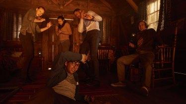 Deborah Ann Woll (left), Taylor Russell, Jay Ellis, Logan Miller and Nick Dodani star in Escape Room.