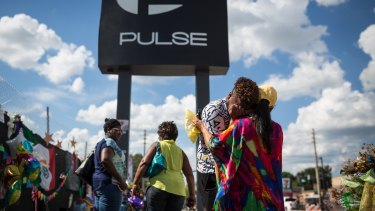 Wayne Dominici, 23, cries on the shoulder of his aunt, Ada Dominici, at a memorial outside Pulse, the gay nightclub where a shooter killed 49 and wounded many more exactly in Orlando, Florida, last month.