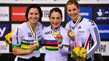 Kristina Vogel of Germany (centre) celebrates winning a gold medal in the keirin, with Australian Anna Meares (left)  taking second and Britain's Rebecca third.