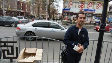 A man sells candles on a street after a power failure in Simferopol, Crimea.