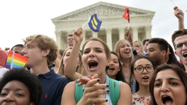 Gay marriage supporters celebrate outside the US Supreme Court in Washington, D.C. on Friday.