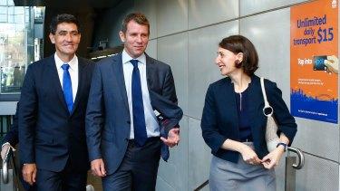 Gladys Berejiklian with Parramatta MP Geoff Lee (left) and Premier Mike Baird at Parramatta Station this week.