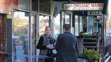 Police outside Joe's Organic Market on Victoria Road.