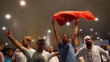 Supporters of President Erdogan chant slogans at Ataturk Airport in Istanbul on Saturday.