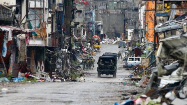 Philippine troops drive through Marawi last month after the city was declared liberated following a months-long siege and battle against Islamist militants.