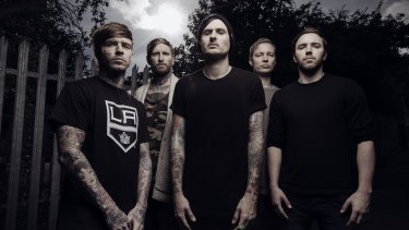 I Killed the Prom Queen guitarist Jona Weinhofen (second from left) tweeted that the band has been detained.