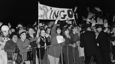 Fans await the arrival of Ringo Starr of the Beatles at Kingsford Smith Airport,Sydney, in June 1964.