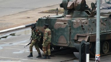 A military tank is seen with armed soldiers on the road leading to President Robert Mugabe's office in Harare, Zimbabwe.