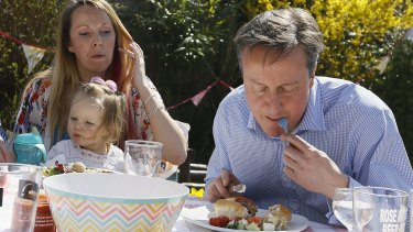 Prime Minister David Cameron has been mocked for eating a hot dog with a knife and fork as he campaigns for Britain's general election next month.