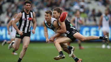 Port's Robbie Gray is tackled by Magpie Tom Langdon, but proved a handful all day.