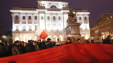 Students protest in front of the Copernicus monument in Warsaw, Poland.