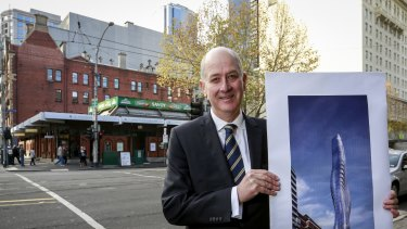 Planning Minister Richard Wynne at the Savoy Tavern site, with a picture of the 68-floor tower.